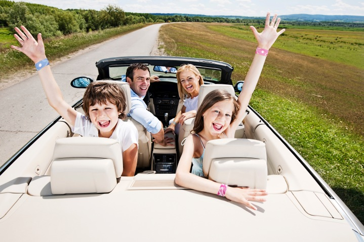Happy family of four people sitting in their cabriolet car. [url=http://www.istockphoto.com/search/lightbox/9786778][img]http://dl.dropbox.com/u/40117171/family.jpg[/img][/url] [url=http://www.istockphoto.com/search/lightbox/9786750][img]http://dl.dropbox.com/u/40117171/summer.jpg[/img][/url]